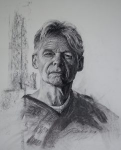 Drawn portrait of a man's head.