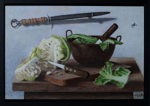 A realistic still life oil painting on wood of cauliflower and a copper pan, with an old knife-grinder at the wall.