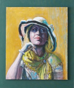 A slightly impressionistic oil painting on wood of a woman with a white hat and summery clothing from the late nineteenth century.